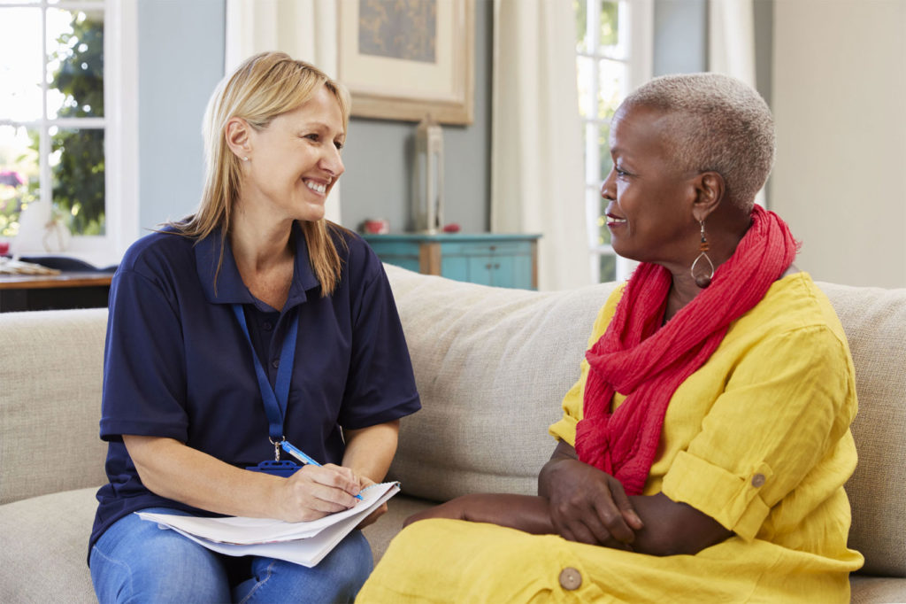 Social worker meeting with elderly woman