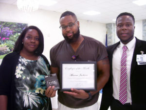Posing for a photo at the employee of the month celebration.